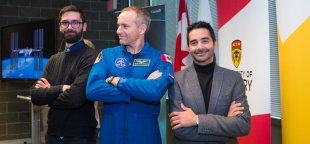 Funding for University of Calgary researcher Giuseppe Iaria's Wayfinding project was announced on Wednesday by the Canadian Space Agency. Pictured with Iaria, at right, are Canadian astronaut David Saint-Jacques, centre, and grad student Ford Burles, a member of the Wayfinding team. Credit: Riley Brandt, University of Calgary.