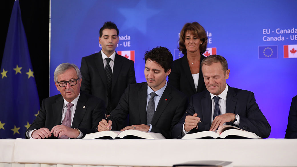 Prime Minister Justin Trudeau, European Commission President Jean-Claude Juncker and European Council President Donald Tusk sign the Comprehensive Economic and Trade Agreement (CETA) during the European Union-Canada Leaders' Summit in Brussels, Belgium..