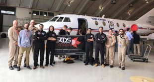 NRC, SEDS Canada and CSA personnel with the Falcon 20 jet which will be used to perform the microgravity research.