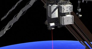 File photo - This artist's concept shows how the Optical Payload for Lasercomm Science (OPALS) laser beams data to Earth from the International Space Station