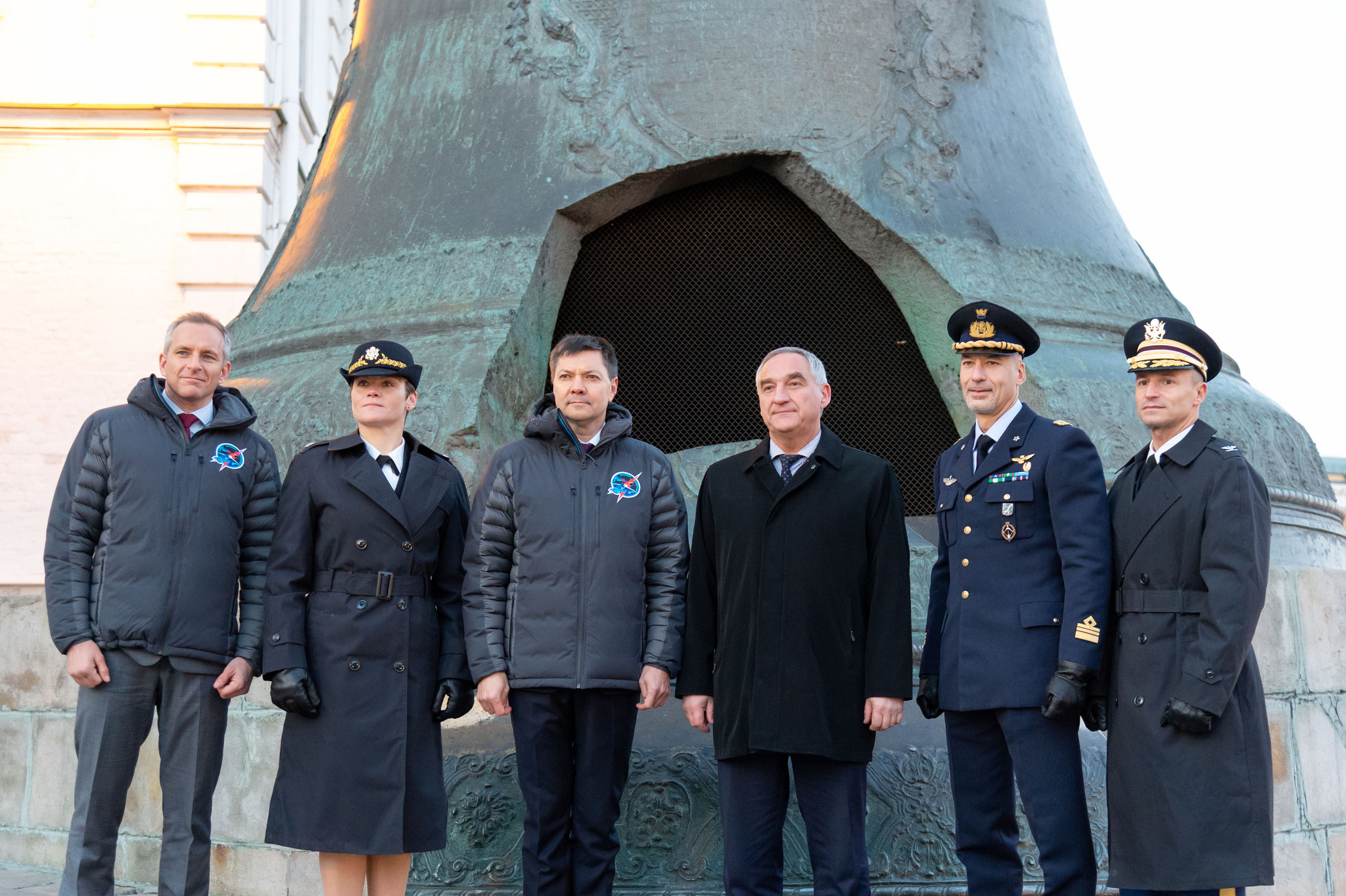 The Expedition 58 prime and backup crew members pose for pictures Nov. 15 in front of the Tsar Bell at the Kremlin in Moscow in traditional ceremonies. Front left to right are the prime crewmembers, David Saint-Jacques of the Canadian Space Agency, Anne McClain of NASA and Oleg Kononenko of Roscosmos, and the backup crew members, Alexander Skvortsov of Roscosmos, Luca Parmitano of the European Space Agency and Drew Morgan of NASA. McClain, Saint-Jacques and Kononenko will launch Dec. 3 on the Soyuz MS-11 spacecraft from the Baikonur Cosmodrome in Kazakhstan for a six-and-a-half month mission on the International Space Station
