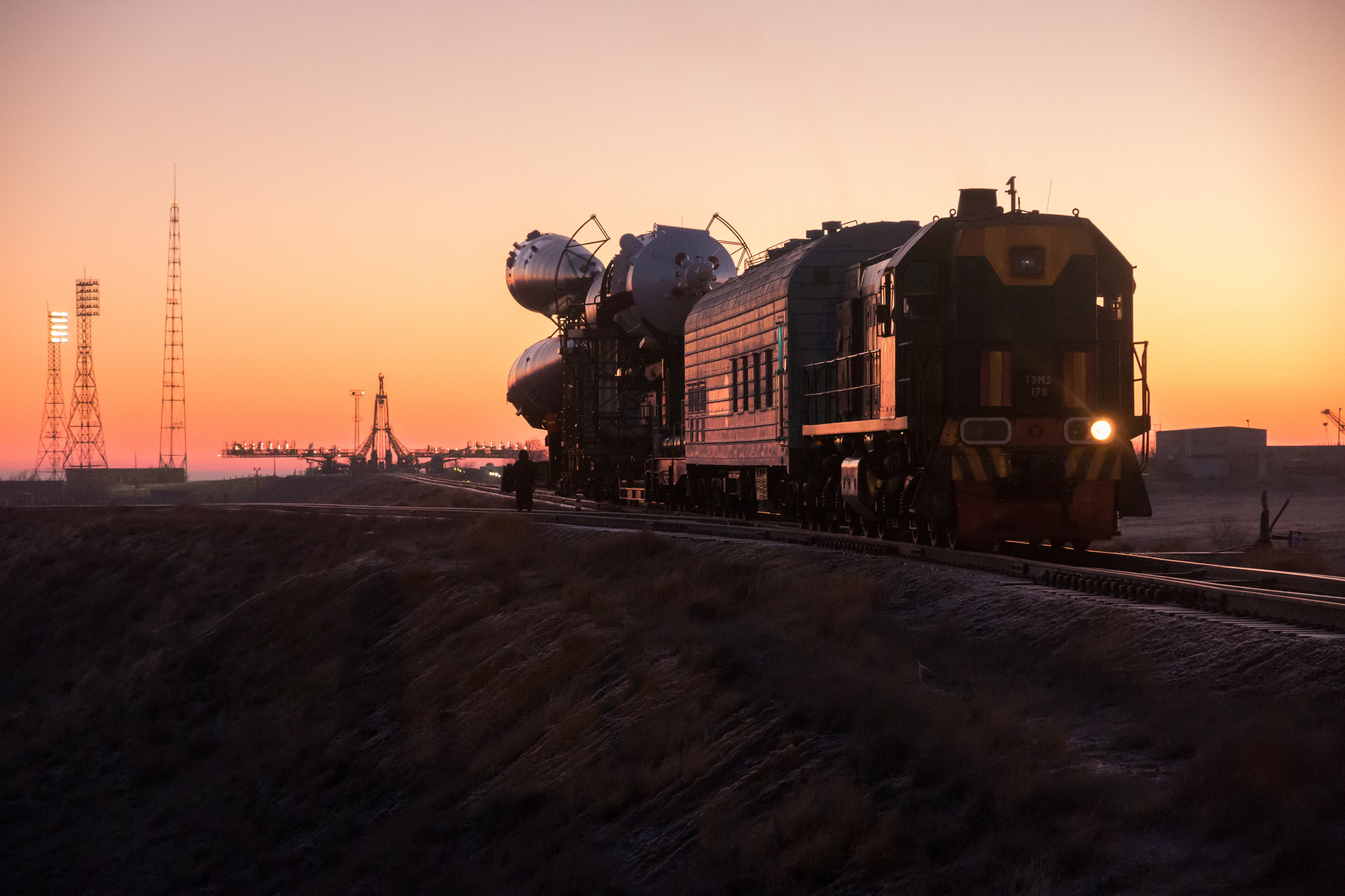 The Soyuz booster rocket and MS-11 spacecraft is rolled out to the launch pad by train on Sat. Dec.1, 2018 at the Baikonur Cosmodrome in Kazakhstan. Launch of the Soyuz rocket is scheduled for Dec. 3 and will carry Expedition 58 Soyuz Commander Oleg Kononenko of Roscosmos, Flight Engineer Anne McClain of NASA, and Flight Engineer David Saint-Jacques of the Canadian Space Agency (CSA) into orbit to begin their six and a half month mission on the International Space Station