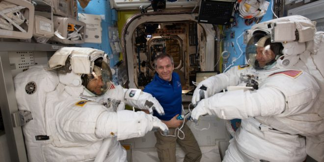 Canadian Space Agency astronaut David Saint-Jacques assists NASA astronauts Christina Koch (left) and Nick Hague as they verify their U.S. spacesuits are sized correctly and fit properly ahead of a set of upcoming spacewalks