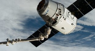 The Canadarm2 robotic arm, commanded by astronaut David Saint-Jacques, reaches out to grapple the SpaceX Dragon cargo craft at its capture point 10 meters from the International Space Station