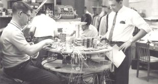 Sam Ayre and Harry Kowalik working on the Alouette 1 mockup spacecraft.
