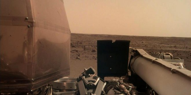 The Instrument Deployment Camera (IDC), located on the robotic arm of NASA's InSight lander, took this picture off the Martian surface on Nov. 26, 2018