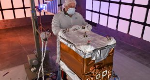 A Ball Aerospace engineer adjusts the thermal insulation on NASA's Green Propellant Infusion Mission spacecraft bus following integration of the propulsion subsystem