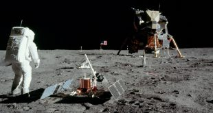 This photographs was taken on the surface of the Moon by Apollo 11 astronaut Neil Armstrong. Fellow moonwalker Buzz Aldrin is setting up the retroreflector and seismometer experiments that are also visible in LROC images of the site. The flag and TV camera are in the background to the left of the Lunar Module