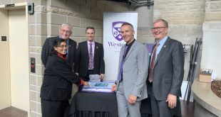 Cutting the cake at the launch of Western University's new Institute for Earth and Space Exploration. From left to right; Dr. Jayshri Sabarinathan, Dr. Ken McIssac, Dr. Jan Cami, Dr. Gordon Osinski and Western president Alan Shepard